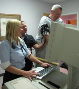 image shows Dr. Noel Peterson giving a stress test to a heart patient in Greenville NC